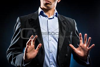 Man in elegant black jacket and blue shirt