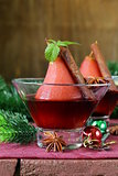 pears cooked in wine with spices (cinnamon and anise) Christmas table setting
