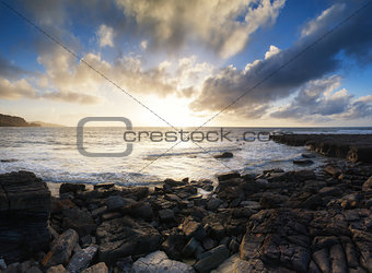 Beautiful seascape at sunset with dramatic clouds landscape imag