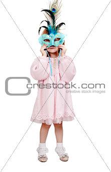 little girl in a fancy mask