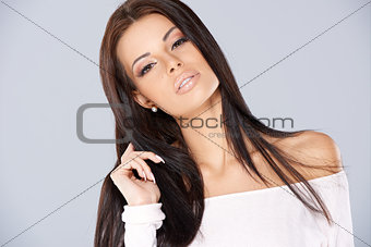 Beautiful girl posing on gray