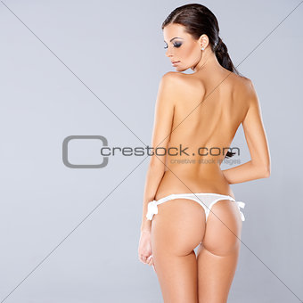 Adorable brunette girl posing isolated