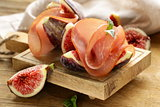 ripe purple figs with smoked ham - a traditional antipasti appetizer