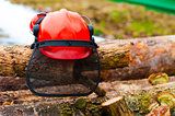 protective helmet lying on the logs in the forest