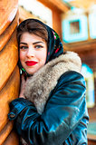 Russian girl with a fur collar smiling
