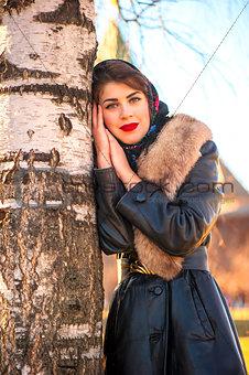 Beautiful Russian girl near birch