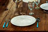 textured wooden worktop and table utensils