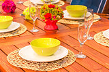 beautifully set table in bright colors