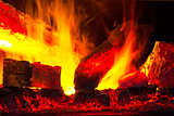 burning down fire logs in macro photography