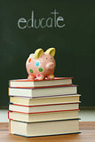 Piggy bank on a pile of books