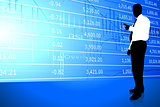 Businessman on Stock Market Background