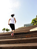 fitness woman running up on wooden stairs