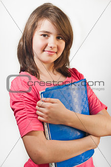 Portrait of smiling teen girl holding books, isolated on white background