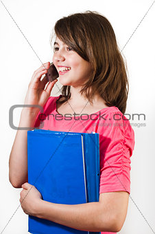 Attractive teenage girl talking on the phone. All on white background