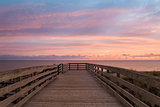 Boardwalk on beach at dawn