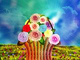 Basket of flowers on meadow