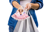 Woman with money and shopping bags