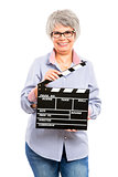 Elderly woman holding a clapboard