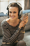 Portrait of happy young woman with headphones and microphone