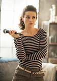 Portrait of thoughtful young woman with microphone