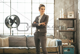 Business woman standing in loft apartment