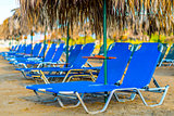 Beach Sunbeds With Straw Umbrellas