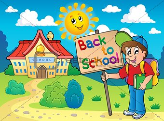 Boy with sign near school