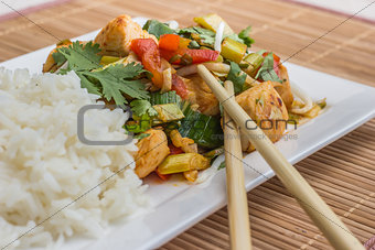 Asian dish with chicken, vegetables and cilantro