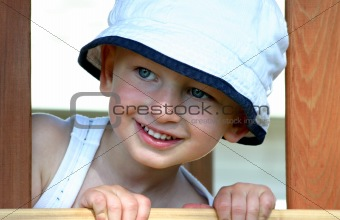 Toddler boy with sun hat