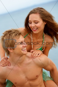A young couple having fun on the beach