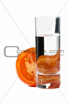 sliced tomato and glass water