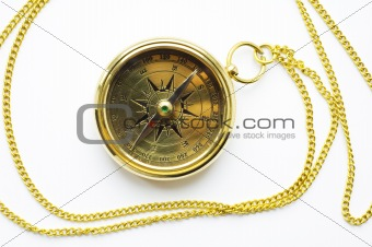 Old style gold compass with chain on white background