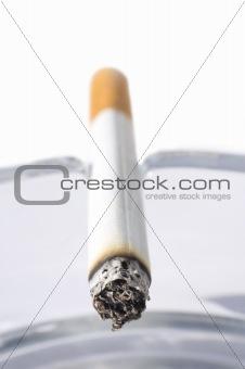 Cigarette in ash tray