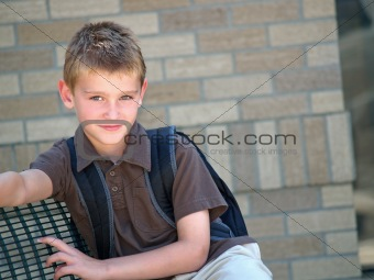 boy at school bus stop