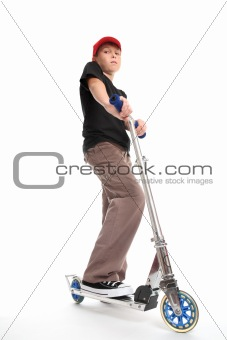 Boy standing on a scooter
