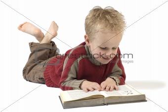 Boy reading a book 4