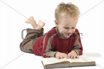 Boy reading a book 1