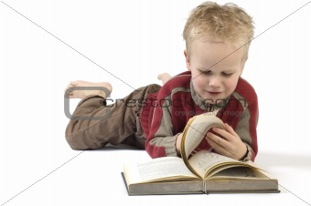 Boy reading a book 6