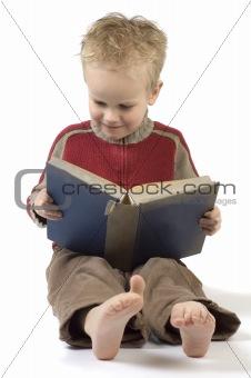 Boy reading a book 7