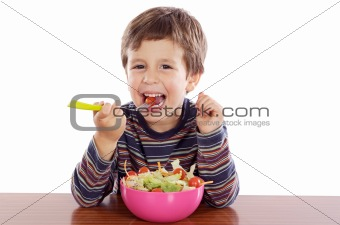Child eating salad