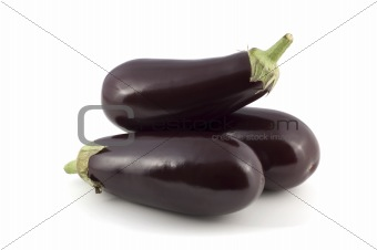 three aubergine on white background