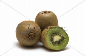 three kiwi on white background
