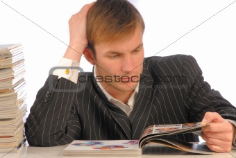 businessman looks magazine