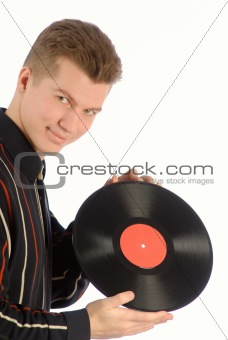 guy holds in hands vinylic disk, color