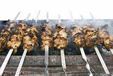 meat kababs on grill isolated over white