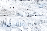 Two people trekking on ice Vatnajokull glacier