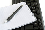 Workplace keyboard, notebook, pen,