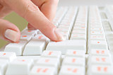 Close-up of typing hands on keyboard