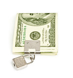 Dollars under lock and key on the white background