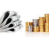 newspapers with stack of coins, business concept